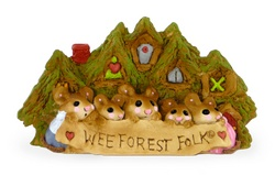 Five mice stand infront of forest home holding a WFF banner