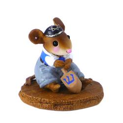 Small boy mouse in a yarmulke and playing with a dreidel