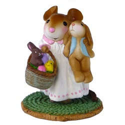 Young girl mouse holding a bunny and a basket of Esater goodies